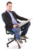 Affärsman läsa en tidning som isolerade — Stockfoto