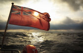 British maritime ensign flag boat and stormy sky — 图库照片
