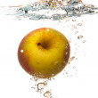 Yellow apple in the water splash over white — Stock Photo #35296649