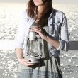 Girl on pier with kerosene lamp — Stockfoto