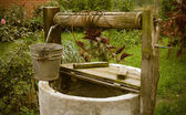 Old rotten water well, rural scenery — Stock Photo