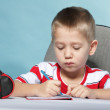 Young cute boy draws with color pencils — Stock Photo #35459749