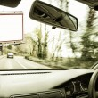 Billboard seen from the inside of a car — Stock Photo