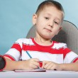 Stock Photo: Young cute boy draws with color pencils