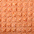 Orange sponge foam as background texture — Stock Photo