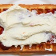 Belgian waffle with jam and whipped cream — Stock Photo