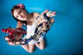 Summer girl plenty of jewellery beads in hands — Stock Photo