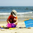 Boy playing toys on beach — Photo