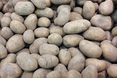 Potatoes in market as background — Stock Photo
