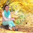 Young girl relaxing in autumnal park. Fall lifestyle concept. — Stock Photo