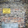 Stock Photo: No entry sign in Poland on old brick wall