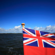 British maritime red ensign flag blue sky — Stock Photo #35951089