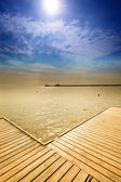 Old wooden pier at the sea — Stock Photo