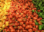 Red yellow bell peppers mix paprika in market — Stock Photo