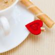 White cup coffe waffle roll with cream heart. Love valentine's day — Stock Photo #36376999