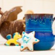 Stock Photo: Blue mug and christmas gingerbread cake star icing decoration