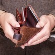 Stock Photo: Businessmshowing empty wallet. Finance and economy.