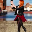 Traveler woman red hair girl with camera old town Gdansk — Stock Photo