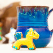 Blue mug and christmas gingerbread cake pony icing decoration — Stock Photo