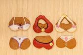 Funny colorful bikini shape gingerbread cakes cookies on bamboo mat — Stock Photo