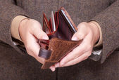 Businessman showing empty wallet. Finance and economy. — Stock Photo