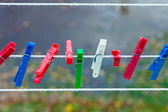 Colorful washing laundry clips on strip outdoor. Background. — Stock Photo