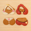 Funny colorful bikini shape gingerbread cakes cookies on bamboo mat — Stock Photo