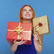 Young happy red haired woman with a gift box isolated — Stock Photo