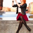 Stock Photo: Traveler woman red hair girl with camera old town Gdansk