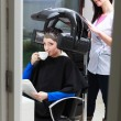 Woman drinking coffee tea in hair beauty salon. By hairdresser. — Стоковая фотография