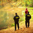 Police officers checking fisherman autumnal park. Fishing inspection. — Stock Photo