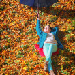 Young girl relaxing with umbrella in autumnal park — Stock Photo #36739247