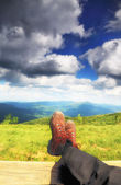Hiking shoes. Hiker enjoying view relaxing — Stock Photo