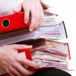 Stock Photo: Female hands holding stack folders documents. Overworked business woman.