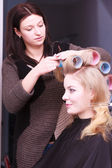 Beautiful blond girl hair curlers rollers hairdresser beauty salon — Stock Photo