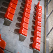 Stock Photo: Closeup of red sport stadium seats. Empty stand. Team sport supporter