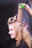 Beautiful blond girl hair curlers rollers hairdresser beauty salon — Stockfoto