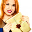 Young happy red haired woman with a gift box isolated — Stock Photo #36951483