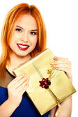 Young happy red haired woman with a gift box isolated — Stock fotografie