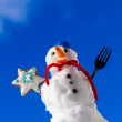 Little happy christmas snowman with cookie star outdoor. Winter season. — Stock Photo