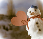 Little happy christmas snowman red heart love symbol outdoor. Winter. — Stock Photo