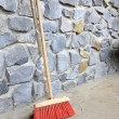 Large broom on wall outdoor - housework — Stock Photo #37203121