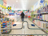 View from shopping cart trolley at supermarket shop. Retail. — Stock Photo