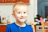 Portrait happy smiling blond boy child kid preschooler at home — Stock Photo