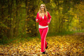 Girl running jogging in autumn fall forest park — Stock Photo