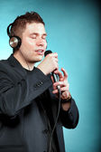 Man singing into microphone — Stock Photo