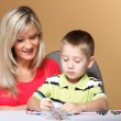 Mother and son drawing together — Stock Photo #37687081