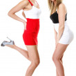 Two sexy women wearing mini skirts — Stock Photo