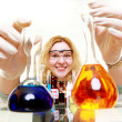 Chemist woman with chemical glassware flask isolated — Stock Photo