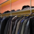 Many clothes in cloakroom — Stock Photo #37805065